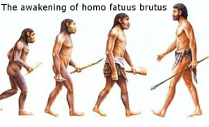 Image captioned 'The awakening', depicting hominids evolving to man (but the 'most advanced' specimen has turned around...)