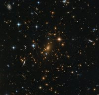 An image taken by Hubble of galaxy cluster RXC J0142.9+4438
