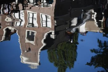 A building reflected in water