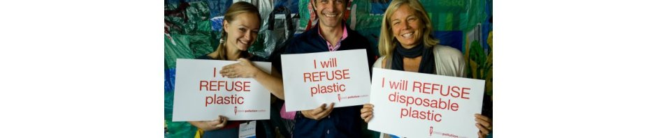 Three humans bearing signs proclaiming they will REFUSE plastic!