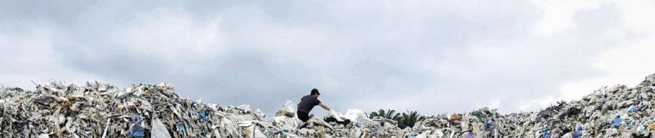 A man atop a heap of rubbish